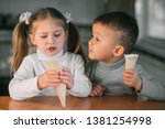 kids boy and girl eating ice... | Shutterstock . vector #1381254998