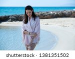 young girl on the beach and... | Shutterstock . vector #1381351502