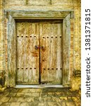 ancient wooden door in old town ... | Shutterstock . vector #1381371815