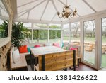 Small photo of Empty room shot of a cosy looking conservatory.