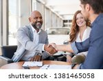 smiling couple buying a new... | Shutterstock . vector #1381465058