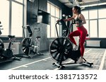 attractive sporty woman in gym. ... | Shutterstock . vector #1381713572