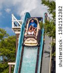 Small photo of JACKSON, NEW JERSEY - JUNE 30: A Family enjoys a log flume ride at Six Flags Great Adventure on June 30 2007 in Jackson New Jersey.