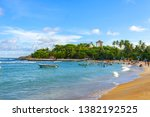 Most popular unawatuna beach on sri lanka, beach with golden sand and palm trees offering activities like snorkeling and scuba diving