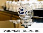 """A Brandy Glass """"tip Box"""" On Th..."""