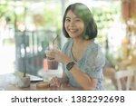 young asian woman short hair in ... | Shutterstock . vector #1382292698