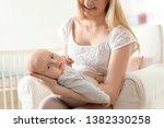 happy mother with her baby... | Shutterstock . vector #1382330258