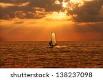 windsurfer sailing in the sea... | Shutterstock . vector #138237098