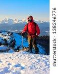 mountaineer with ice axe... | Shutterstock . vector #138246776