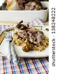 Pork knuckle with sauerkraut and mushroom sauce - stock photo