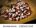 beans in a wooden plate on a... | Shutterstock . vector #1382621165