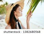 woman in a hat on an island in ... | Shutterstock . vector #1382680568