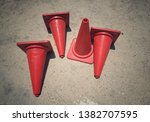 red traffic cone on gray cement ... | Shutterstock . vector #1382707595