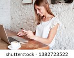 young charming woman using... | Shutterstock . vector #1382723522