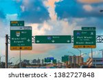 Road sign on 95 interstate freeway northbound in Miami, USA