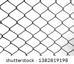 mesh fence and white wall. | Shutterstock . vector #1382819198