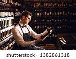 Elegant Wine Seller Holding A...