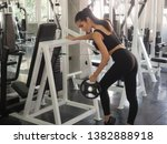 woman exercising in the gym... | Shutterstock . vector #1382888918