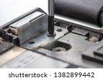 the screwdriver unscrews the...   Shutterstock . vector #1382899442