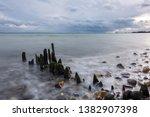 stony beach at baltic sea under ... | Shutterstock . vector #1382907398