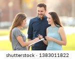 happy couple asking a survey... | Shutterstock . vector #1383011822