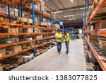 working at warehouse. two... | Shutterstock . vector #1383077825