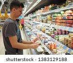 man making choise from shelf in ... | Shutterstock . vector #1383129188