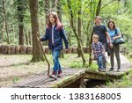 happy family are doing hiking... | Shutterstock . vector #1383168005