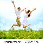 happy couple outdoor. jumping... | Shutterstock . vector #138324326
