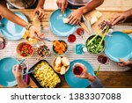 people eating together in... | Shutterstock . vector #1383307088