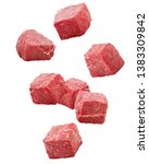 Small photo of Falling meat, beef, cube, isolated on white background, clipping path, full depth of field