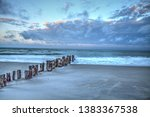 Dawn Over A Dilapidated Pier On ...