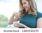 beautiful young woman drinks... | Shutterstock . vector #1383530255