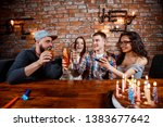 young friends celebrate the... | Shutterstock . vector #1383677642