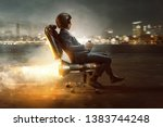 Small photo of Businessman rolls on office chair with rocket motor