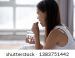 young woman sit in bed feeling... | Shutterstock . vector #1383751442