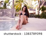 portrait of bikini girl sitting ...   Shutterstock . vector #1383789398