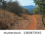 Dirt Road On A Hill Side