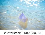 Paper Boat In The Water