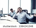 cheerful man in office... | Shutterstock . vector #1384241348
