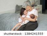 great grandmother hugs two...   Shutterstock . vector #1384241555