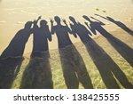 people shadow on beach half on... | Shutterstock . vector #138425555