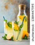 two glass with lemonade or... | Shutterstock . vector #1384447595