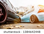 two tuned cars. light blue and...   Shutterstock . vector #1384642448