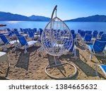 view of sunbeds on the beach in ... | Shutterstock . vector #1384665632