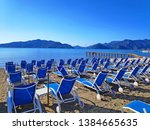 view of sunbeds on the beach in ... | Shutterstock . vector #1384665635