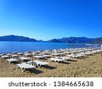 view of sunbeds on the beach in ... | Shutterstock . vector #1384665638