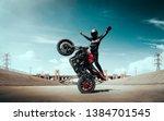 Moto Rider Making A Stunt On...
