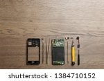 disassembled mobile phone and...   Shutterstock . vector #1384710152