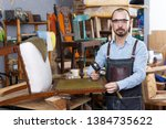positive craftsman engaged in... | Shutterstock . vector #1384735622